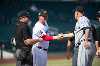 Mesa Solar Sox manager Lou Marson (4) shakes hands with Peoria Javelinas manager Daren Brown (43) in front of home plate umpire Bryan Fields before an Arizona Fall League game at Sloan Park on October 24, 2018 in Mesa, Arizona. Mesa defeated Peoria 4-3. (Zachary Lucy/Four Seam Images)