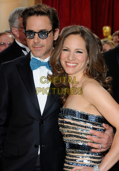 ROBERT DOWNEY JR. & SUSAN DOWNEY .Attending the 82nd Annual Academy Awards held at the Kodak Theatre, Hollywood, California, USA, .March 7th, 2010..oscars arrivals half length  Levin blue bow tie tuxedo tux tinted glasses beard facial hair stubble strapless peach beige silver grey gray beaded dress white shirt .CAP/ADM/BP.©Byron Purvis/Admedia/Capital Pictures