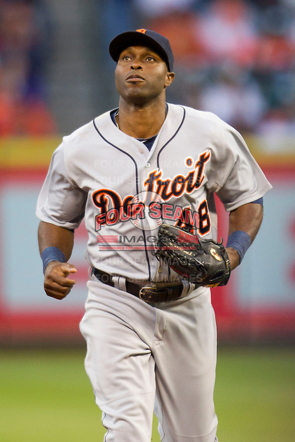Detroit Tigers outfielder Torii Hunter (48) heads to the dugout during the MLB baseball game against the Houston Astros on May 3, 2013 at Minute Maid Park in Houston, Texas. Detroit defeated Houston 4-3. (Andrew Woolley/Four Seam Images).