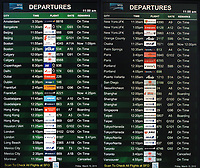 Sign showing the airline flight departure schedule in the international terminal of San Francisco International airport (SFO), San Francisco, California