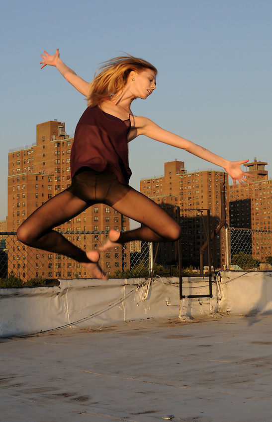 Gregory Holmgren Photographer, NYC dance, movement project with model, Julie Justine at The ClockTower Rooftop, Bronx, New York, New York, September 12, 2012.