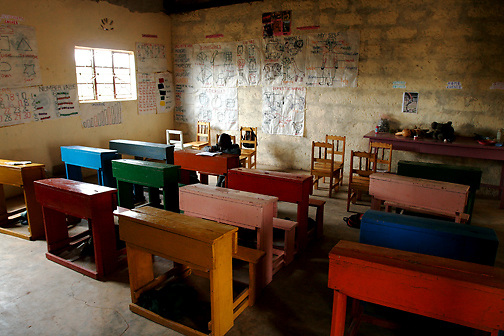 Antony Kimathi sits alone at the end of the class final at the Early Childhood Development school at Pepo La Tumaini Jangwani, a community based HIV/AIDS program in Isiolo, Kenya., on Tuesday, July  29, 2008.  (Photo by Bryce Yukio Adolphson, © 2008)