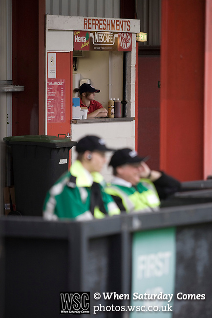 Medical personnel and staff at the refreshment kiosk in the Wulvern Housing stand watching the League 2 fixture between Crewe Alexandra and Aldershot Town at the Alexandra Stadium. The visitors won by 2 goals to 1.