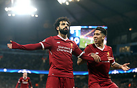 Liverpool's Mohamed Salah (left) celebrates with team mate Roberto Firmino after scoring his side's equalising goal to make the score 1 - 1<br /> <br /> Photographer Rich Linley/CameraSport<br /> <br /> UEFA Champions League Quarter-Final Second Leg - Manchester City v Liverpool - Tuesday 10th April 2018 - The Etihad - Manchester<br />  <br /> World Copyright &copy; 2017 CameraSport. All rights reserved. 43 Linden Ave. Countesthorpe. Leicester. England. LE8 5PG - Tel: +44 (0) 116 277 4147 - admin@camerasport.com - www.camerasport.com