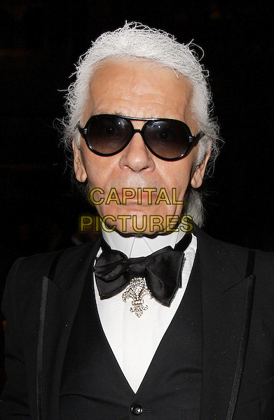 KARL LAGERFELD.Arrivals at the Chanel pre Autumn / Winter Collection Show at Phillips de Pury & Co, Victoria, London, England..December 6th, 2007.headshot portrait sunglasses shades bow tie fleur-de-lis pin brooch.CAP/ROS.©Steve Ross/Capital Pictures