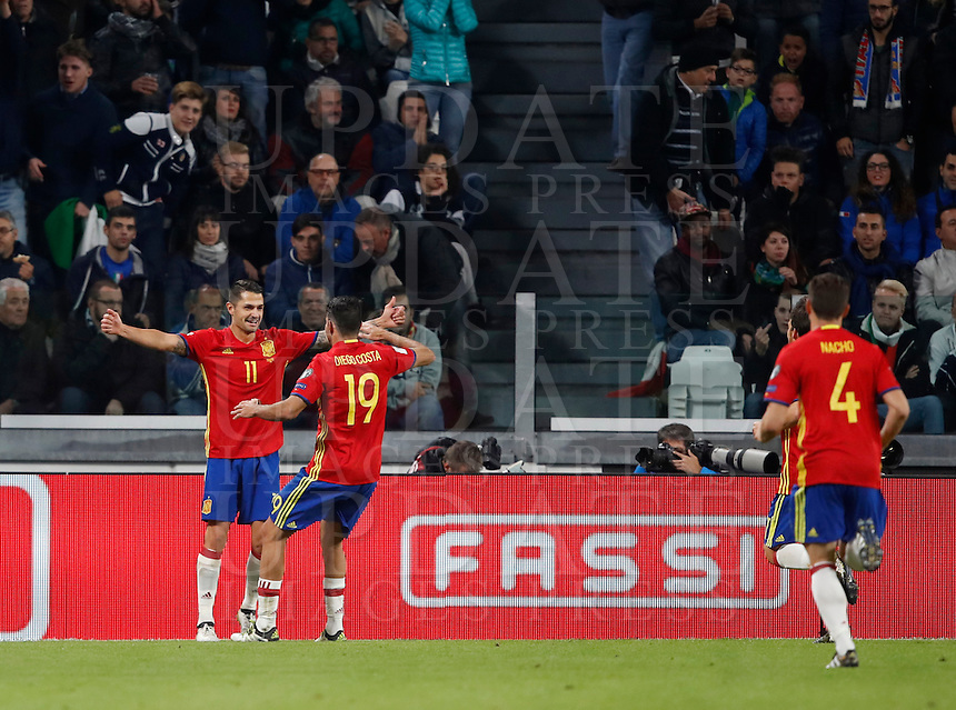 Spain Vitolo, left, celebrates with teammates Diego Costa, center, and Nacho, after scoring during the Fifa World Cup 2018 qualification soccer match between Italy and Spain at Turin's Juventus Stadium, October 6, 2016. The game ended 1-1.<br /> UPDATE IMAGES PRESS/Isabella Bonotto