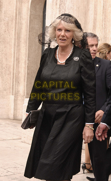 "CAMILLA DUCHESS OF CORNWALL.Britain's Prince Charles called for ""inspired leadership"" against global warming to save the environment for future generations in a speech Monday to Italian lawmakers and other VIPs at the start of a royal visit to Rome, Italy, .27th April 2009..HRH half length black jacket suit veil  Parker Bowles dress veil clutch bag  .CAP/ADM/LIV.©Liverani/Admedia/Capital Pictures"