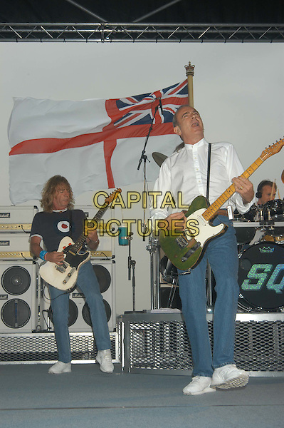 STATUS QUO.Performing live gig aboard the HMS Ark Royal in Portsmouth.Ref: PL.stage, live, music, performing, singing, full length, full-length.www.capitalpictures.com.sales@capitalpictures.com.©Capital Pictures.
