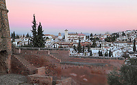 Church of San Nicolas at sunrise, originally built in the 16th century in Mudejar style but rebuilt 1932 after a fire, and El Albayzin, the medieval Moorish old town of Granada, seen from the Alhambra Palace, Granada, Andalusia, Southern Spain. From the 8th to the 15th centuries, Granada was under muslim rule and retains a distinctive Moorish heritage. Granada was listed as a UNESCO World Heritage Site in 1984. Picture by Manuel Cohen
