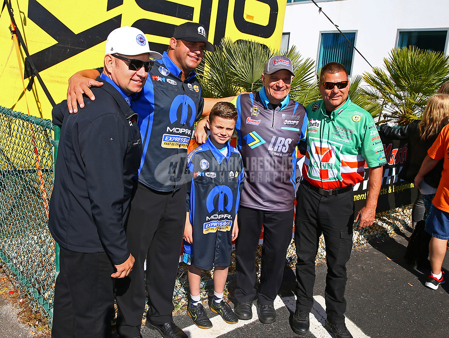 Mar 19, 2017; Gainesville , FL, USA; NHRA funny car driver Matt Hagan and son Colby Hagan with Robert Hight, Bob Tasca III and Jim Campbell during the Gatornationals at Gainesville Raceway. Mandatory Credit: Mark J. Rebilas-USA TODAY Sports