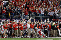 The Ohio State Buckeyes sideline celebrates after a fourth down pass by Oregon was incomplete late in the fourth quarter of the College Football Playoff National Championship at AT&T Stadium in Arlington, TX on Monday, January 12, 2015. (Columbus Dispatch photo by Jonathan Quilter)