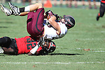 Southern Illinois Salukis wide receiver John Lantz (13) was tackled and rolled onto the ground by Southeast Missouri State Redhawks cornerback Reggie Jennings (32, bottom) in the third quarter after Lantz made a reception. The Southern Illinois University - Carbondale (SIUC) Salukis defeated the host Southeast Missouri State University (SEMO) Redhawks 36-19 in an NCAA football game at Busch Stadium on Saturday September 21, 2013.