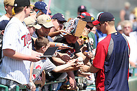 Minnesota Twins designated hitter Justin Morneau #33 signs autographs during practice before a spring training game against the Pittsburgh Pirates at McKechnie Field on March 10, 2012 in Bradenton, Florida.  Minnesota defeated Pittsburgh 4-2.  (Mike Janes/Four Seam Images)