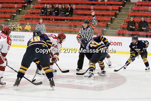Opening face-off between Alex Killorn (Harvard - 19) and Yuri Bouharevich (Quinnipiac - 13). - The visiting Quinnipiac University Bobcats defeated the Harvard University Crimson 3-1 on Wednesday, December 8, 2010, at Bright Hockey Center in Cambridge, Massachusetts.