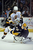 February 17th 2007:  Ryan Miller (30) of the Buffalo Sabres grabs the puck vs. the Boston Bruins as Brad Boyes (26) applies pressure at HSBC Arena in Buffalo, NY.  The Bruins defeated the Sabres 4-3 in a shootout.