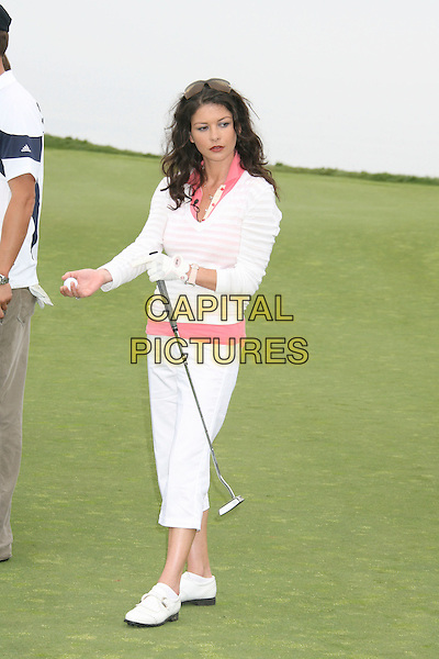 CATHERINE ZETA-JONES .9th Annual Michael Douglas & Friends Celebrity Golf Event.held at the Trump National Golf Club, Rancho Palos Verdes, California, USA. .April 29th, 2007.sport full length white pink striped stripes top cropped beige trousers beige club glove.CAP/ADM/RE.©Russ Elliot/AdMedia/Capital Pictures