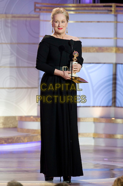 "MERYL STREEP.Accepts the Golden Globe Award for BEST PERFORMANCE BY AN ACTRESS IN A MOTION PICTURE - COMEDY OR MUSICAL for her role in ""Julie & Julia"" at the 67th Annual Golden Globe Awards at the Beverly Hilton in Beverly Hills, CA, USA..January 17th, 2010.                               .globes stage microphone full length black off the shoulder dress award trophy winner  .CAP/AW/HFPA.Supplied by Anita Weber/Capital Pictures"