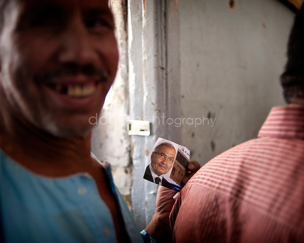EGYPT - ON THE ROAD TO THE POLLING STATIONS .copyright : Magali Corouge / Documentography.22th of may 2012, Egypt. ..A polling station in Garbage City, Cairo..