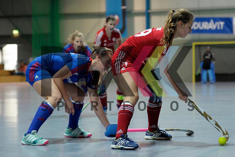 GER - Mannheim, Germany, December 19: During the 1. Bundesliga Sued Damen indoor hockey match between Mannheimer HC (blue) and Nuernberger HTC (red) on December 19, 2015 at Irma-Roechling-Halle in Mannheim, Germany.  Julia Meffert #97 of Mannheimer HC, Alexandra Zink #79 of Nuernberger HTC<br /> <br /> Foto &copy; PIX-Sportfotos *** Foto ist honorarpflichtig! *** Auf Anfrage in hoeherer Qualitaet/Aufloesung. Belegexemplar erbeten. Veroeffentlichung ausschliesslich fuer journalistisch-publizistische Zwecke. For editorial use only.