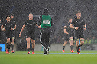 A wet afternoon at Twickenham during the QBE International match between England and New Zealand on Saturday 8th November 2014 (Photo by Rob Munro)