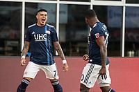 FOXBOROUGH, MA - JULY 27:  Gustavo Bou #7, Cristian Penilla #70 celebrate the goal at Gillette Stadium on July 27, 2019 in Foxborough, Massachusetts.