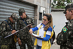 RECIFE, BRAZIL - JANUARY 9: Brazilian soldiers working with the Environmental Health Department go door to door encouraging and educating residents about how to clean up standing water, which provides perfect breeding ground for the zika-carrying mosquitoes, in Recife, Pernambuco, Brazil, on Saturday, Jan. 9, 2016<br /> <br /> The mosquito-borne Zika virus continues to spread in Brazil, alarming health officials and expecting mothers that their babies will be born with abnormal brain development called microcephaly. While researchers have yet to make a connection, Brazil has the highest number of babies born with mircocephaly - the most cases in Recife, Pernambuco - from mothers who tested positive to the Zika virus. There are about 3,530 suspected cases of zika-related microcephaly in Brazil.