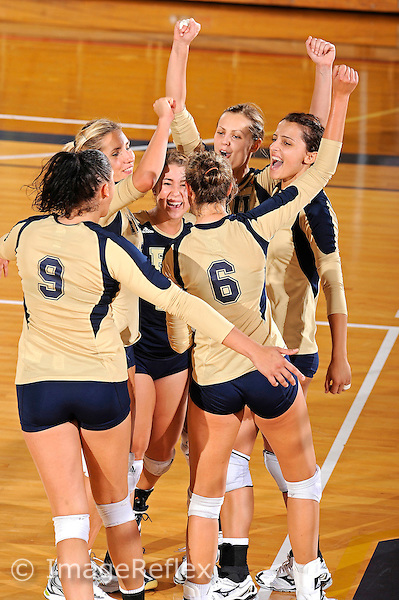 11 September 2011:  FIU's team (pictured, Silvia Carli (9), Marija Prsa (10), Carolyn Fouts (17), Jessica Egan (6), Una Trkulja (7), Andrea Lakovic (1)) celebrate winning a key point as the FIU Golden Panthers defeated the Florida A&M University Rattlers, 3-0 (25-10, 25-23, 26-24), at U.S Century Bank Arena in Miami, Florida.