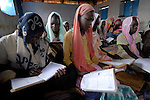 Girls studying in the Dereig Camp for internally displaced persons, one of many such settlements for people displaced by the violence in Darfur.