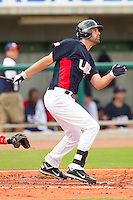 Jordan Danks #15 of the United States World Cup/Pan Am Team follows through on his swing against Team Canada at the USA Baseball National Training Center on September 28, 2011 in Cary, North Carolina.  (Brian Westerholt / Four Seam Images)