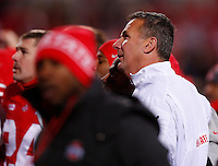 "Ohio State Buckeyes head coach Urban Meyer sings ""Carmen Ohio"" with his players following a 42-14 win over Indiana in Saturday's NCAA Division I football game at Ohio Stadium in Columbus on November 23, 2013. (Barbara J. Perenic/The Columbus Dispatch)"