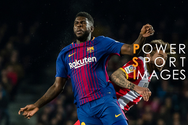 Samuel Umtiti of FC Barcelona (L) fights for the ball with Cristian Portugues Manzanera, Portu, of Girona FC (R) during the La Liga 2017-18 match between FC Barcelona and Girona FC at Camp Nou on 24 February 2018 in Barcelona, Spain. Photo by Vicens Gimenez / Power Sport Images
