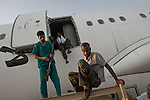 Remi OCHLIK/IP3 PRESS - On august, 27, 2011 In Tripoli - Rebel fighters and doctors visit the Tarmac of the Tripoli airport and the Gaddafi plane which was ready to leave