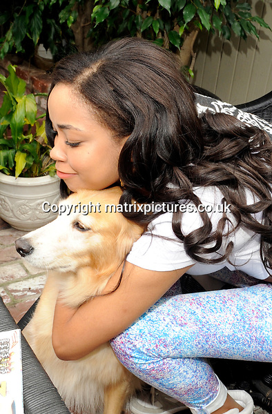 EXCLUSIVE PICTURE: RED CARPET ARRIVALS / MATRIXPICTURES.CO.UK.PLEASE CREDIT ALL USES..UK AND AUSTRALIA RIGHTS ONLY..British teen pop singer and TV presenter Dionne Bromfield is pictured on a short holiday in Beverly Hills, Los Angeles...The goddaughter of deceased British soul singer Amy Winehouse visits the salon of celebrity hairdresser Ken Paves...APRIL 4th 2013..REF: MTX 132227