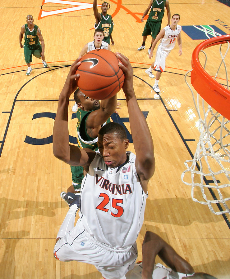 Dec. 20, 2010; Charlottesville, VA, USA; Virginia Cavaliers forward Akil Mitchell (25) grabs a rebound in front of Norfolk State Spartans guard/forward Rob Hampton (1) during the game at the John Paul Jones Arena. Virginia won 50-49. Mandatory Credit: Andrew Shurtleff