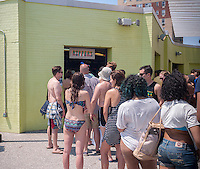 Beachgoers on line at the Rippers concession at Rockaway Beach in the Queens borough of New York on Sunday, July 19, 2015.  The temperature climbed to 93 F with Monday expected to hit 92 F making them the first and second over 90 days of the year. If Tuesday hits 90 the city will have its first heat wave of the year. (© Richard B. Levine)
