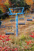Neglected chairlift at abandoned ski resort.