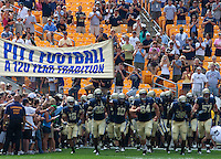 Pittsburgh Panther team taking the field. The Pittsburgh Panthers defeated the Youngstown State Penguins 38-3 at Heinz Field on September 5, 2009.