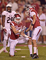 STAFF PHOTO BEN GOFF  @NWABenGoff -- 09/20/14 <br /> Arkansas kicker John Henson celebrates a successful extra point with holder Matt Emrich during the fourth quarter of the game against Northern Illinois in Reynolds Razorback Stadium in Fayetteville on Saturday September 20, 2014.