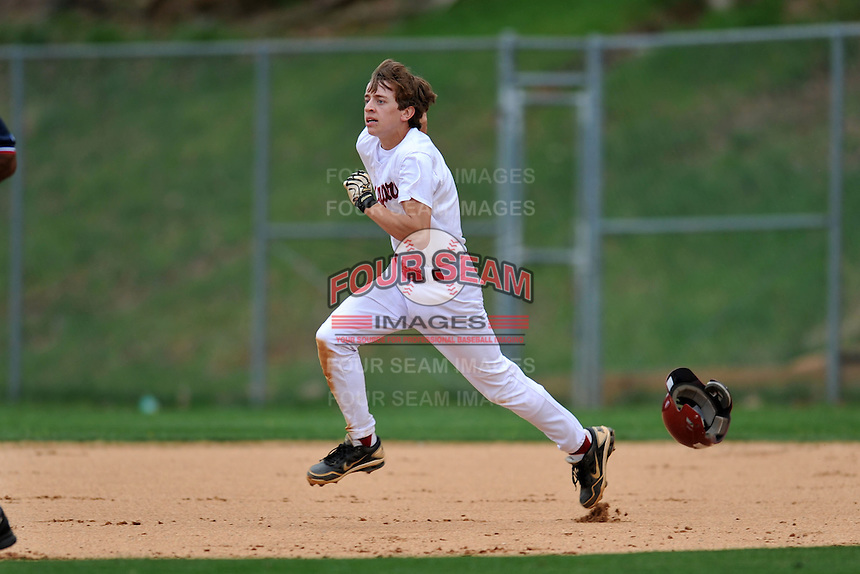 Asheville Cougars second baseman Josh Weidie #4 runs to second during a game against the T.C. Roberson Rams  at Asheville High on April 15, 2013 in Asheville, North Carolina. The Rams won 4-1. (Tony Farlow/Four Seam Images).