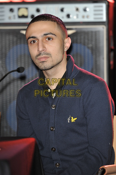 Adam Deacon.Unveiling of the 'Knotted Gun' statue for the Non Violence Foundation, Gibson Guitar Studio, London, England. .8th December 2011.half length blue shirt stubble facial hair  .CAP/MAR.© Martin Harris/Capital Pictures.