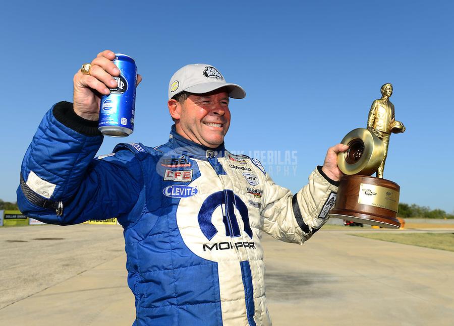 Sept. 23, 2012; Ennis, TX, USA: NHRA pro stock driver Allen Johnson celebrates after winning the Fall Nationals at the Texas Motorplex. Mandatory Credit: Mark J. Rebilas-