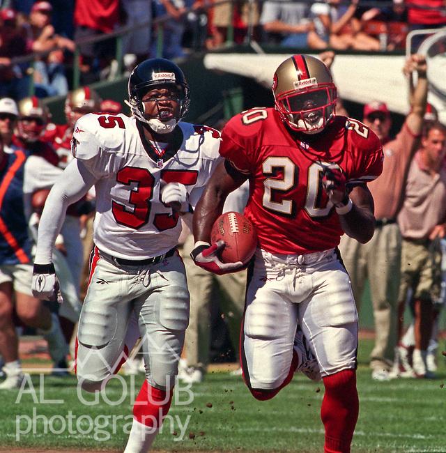 San Francisco 49ers vs. Atlanta Falcons at Candlestick Park Sunday, September 21, 1997.  49ers beat Falcons  34-7.  San Francisco 49ers running back Garrison Hearst (20) out runs Atlanta Falcons defensive back William White (35).