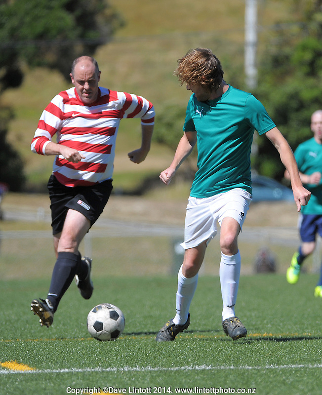 Action from the Capital Football preseason match between the Island Bay Marmosets (green) and Naenae Nighthawks (white and red stripes) at Wakefield Park, Wellington, New Zealand on Saturday, 1 March 2014. Photo: Dave Lintott / lintottphoto.co.nz