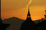 San Francisco's city hall rotunda is prominent in the foreground as Mount Diablo is silhouetted by the morning sunrise.