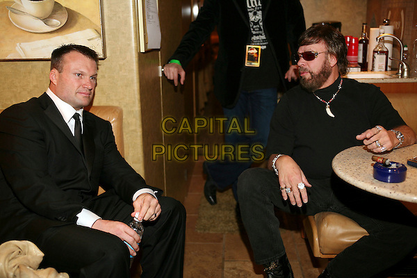 ZACH THOMAS & HANK WILLIAMS JR. .The NFL Alumni Awards held at the Seminole Hard Rock,.Hollywood, Florida, USA, 2 February 2007..half length sitting smoking cigar table ashtray.CAP/ADM/RR.©Randi Radcliff/AdMedia/Capital Pictures.