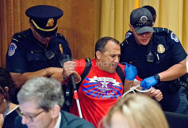 A protestor is forcibly removed from the room by United States Capitol Police as the US Senate Committee on Finance was to conduct the &quot;Hearing to Consider the Graham-Cassidy-Heller-Johnson Proposal&quot; on the repeal and replace of the Affordable Care Act (ACA) also known as &quot;ObamaCare&quot; in Washington, DC on Monday, September 25, 2017.<br /> Credit: Ron Sachs / CNP /MediaPunch