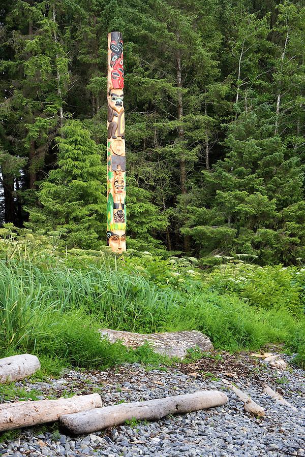 Wooch Jin Dul Shat Kooteeya totem pole stands by pebble beach, Sitka National Historical Park, Sitka, Alaska, USA