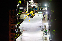 Ambrus Miklosvari from Hungary performs his trick during the freestyle skiing competition held on the 35 meters high artificial ski jumping ramp on the Monster Energy Fridge Festival in central Budapest, Hungary on November 12, 2011. ATTILA VOLGYI