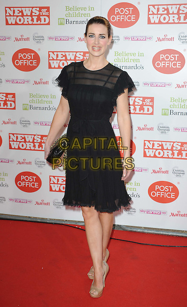KIRSTY GALLACHER .arriving at the News Of The World Children's Champion Awards 2011 at the Grosvenor House Hotel, London, England, UK, 30th March 2011..full length black dress clutch bag open toe gold shoes  sheer .CAP/WIZ.© Wizard/Capital Pictures.