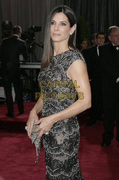 Sandra Bullock.85th Annual Academy Awards held at the Dolby Theatre at Hollywood & Highland Center, Hollywood, California, USA..February 24th, 2013.oscars half length black dress beads side beaded lace clutch bag.CAP/ADM.©AdMedia/Capital Pictures.
